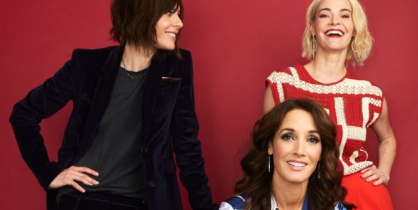 Katherine Moenning smiles fondly at a laughing Leisha Hailey as they, along with Jennifer Beals, pose for a press photo.