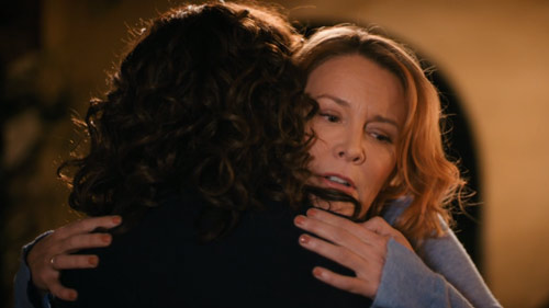 Tina and Bette embrace outside Bette's house