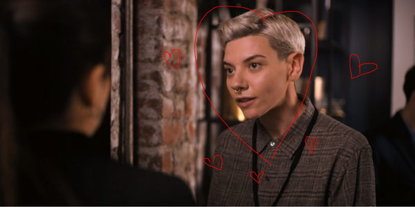 We draw a heart around the face of the lesbian extra.