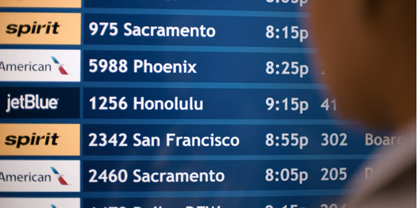 The departures board shows both Honolulu and Kansas City.