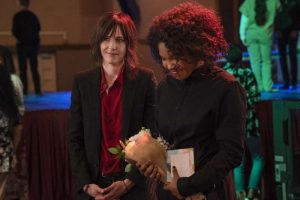 Angie holds flowers with Shane standing behind her on The L Word Generation Q